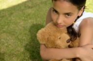 Young carer with teddy